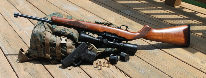 The Ruger 10/22 (shown here with Glock Model 27) is a reliable, accurate and versatile rifle for small game hunting.